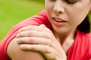 woman clutching painful shoulder